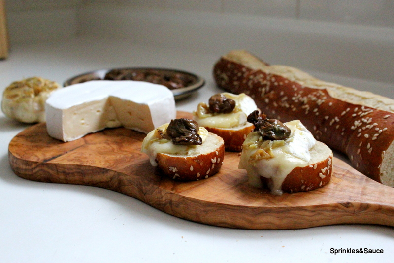 Smoked Oyster and Brie Crostini with Roasted Garlic