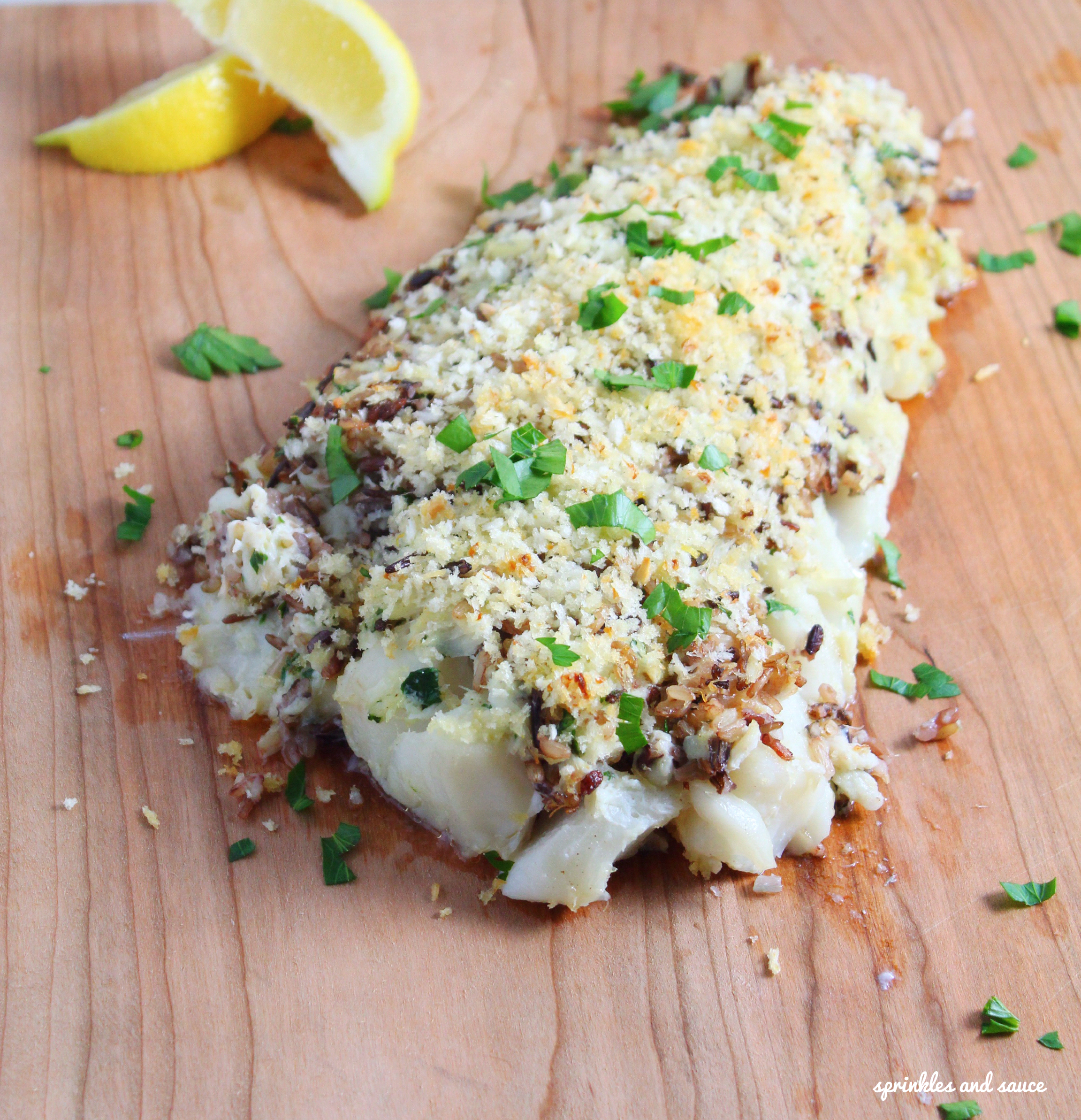 Haddock topped with crab and wild rice sprinkles and sauce for Crab topping for fish