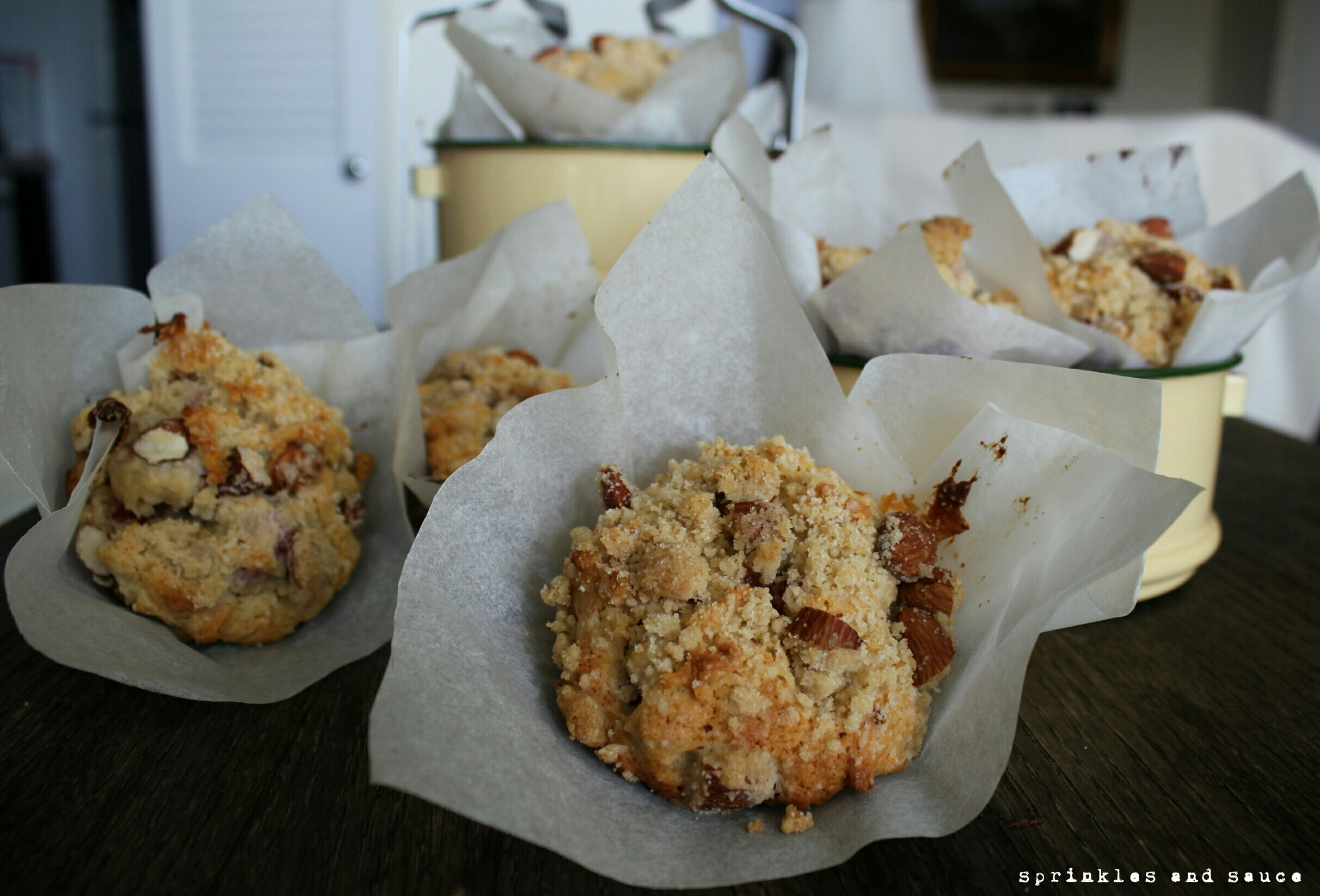 Rhubarb Muffins with Almond Streusel - sprinkles and sauce